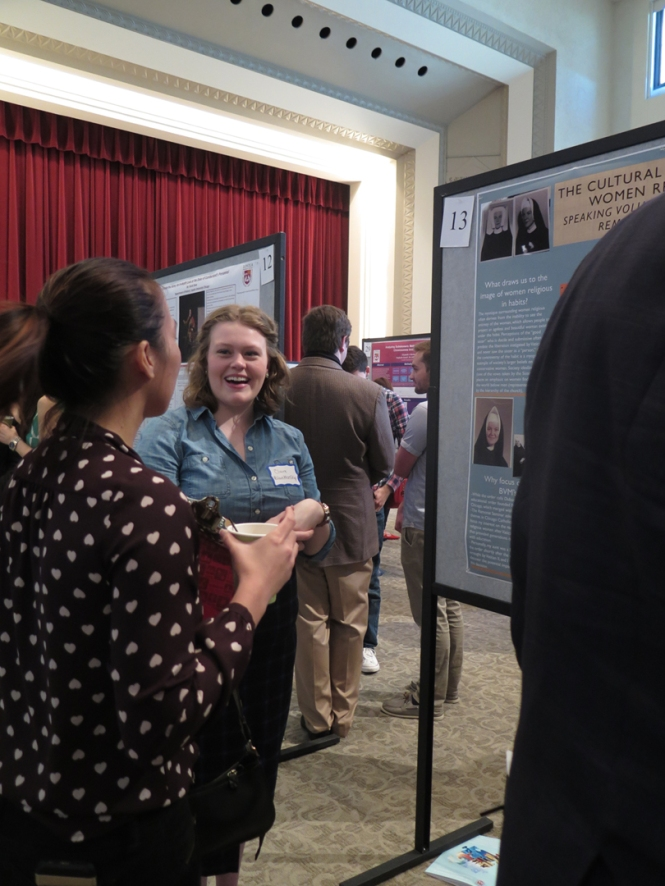 Claire Blankenship talking to another judge about her poster in the first session.