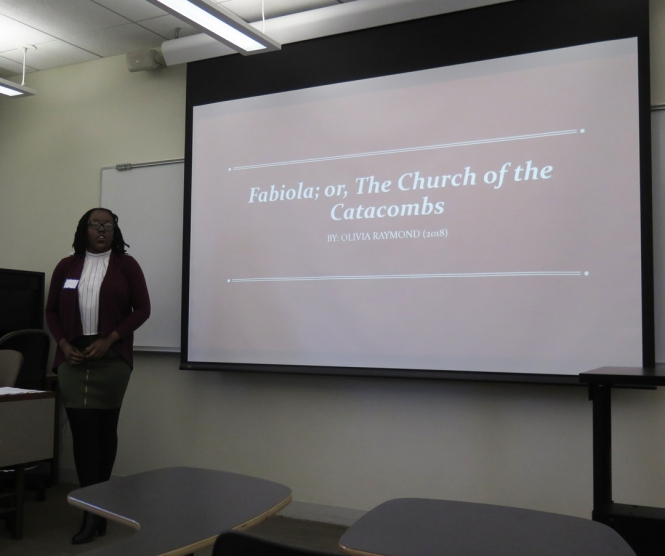 "Ramonat Scholar Olivia Raymond gives an oral presentation on ""Fabiola: or, The Church of the Catacombs."""