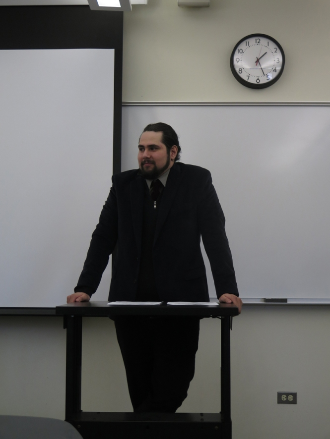 "Ramonat Scholar and Mulcahy Scholar Hector Bahena gives an oral presentation on ""Cardinal George William Mundelein: Chicago Catholicism from 1929-1933."""