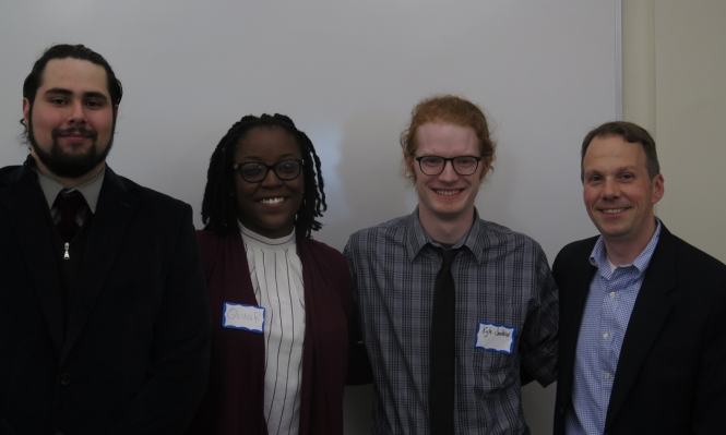 Ramonat Scholars Hector Bahena and Olivia Raymond, Secondary Education and History Major Kyle Jenkins, and Prof. Kyle Roberts.