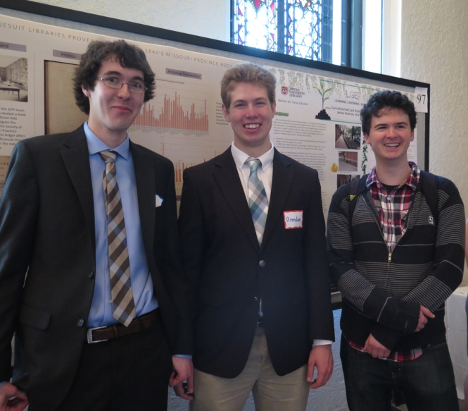 Ramonat Scholars Dan Snow, Brendan Courtois, and Andrew Kelly in front of Dan and Brendan's poster.