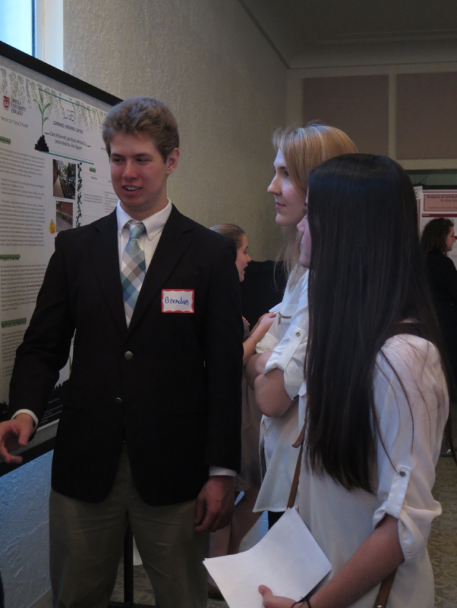 Ramonat Scholar Brendan Courtois explains his research to fellow Scholar Maya Sheikh.
