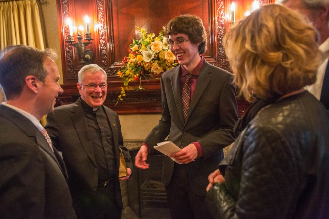 Ramonat Scholarly Prize winner Dan Snow is congratulated by Prof. Kyle Roberts and Dean of the College, Tom Regan, S.J.